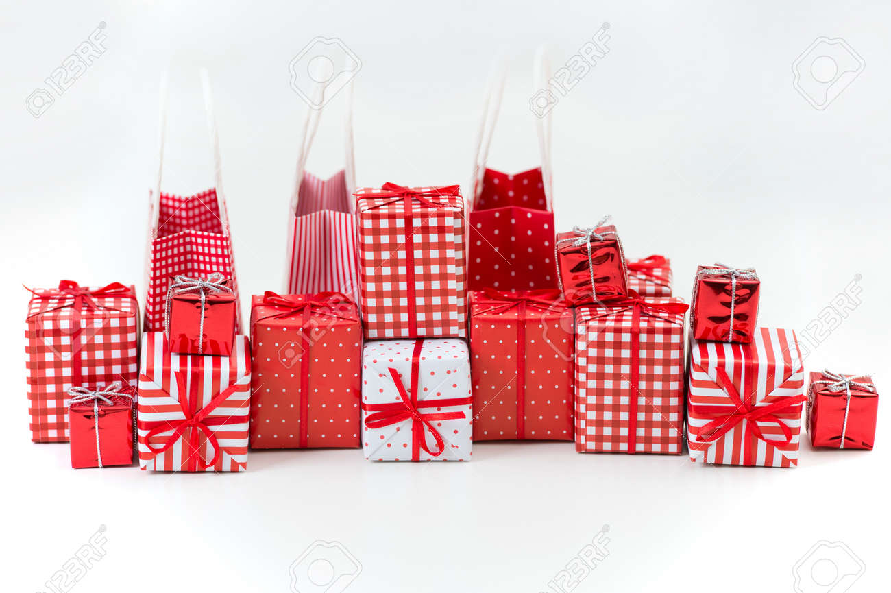 gift boxes with xmas presents wrapped in red paper with ornament on white background stock photo - Xmas Presents
