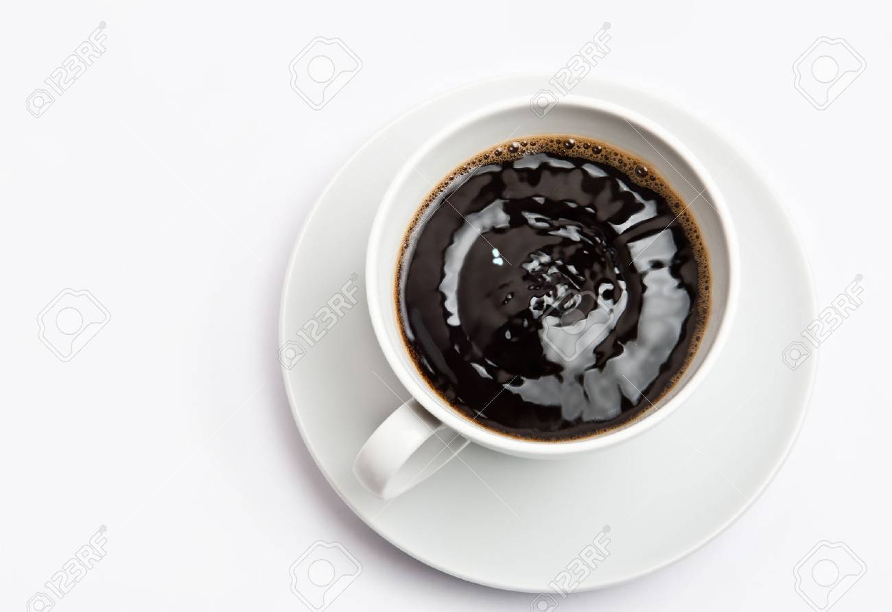 White cup of hot bracing coffee. Beverage is shaking and full of energy Stock Photo - 27498825