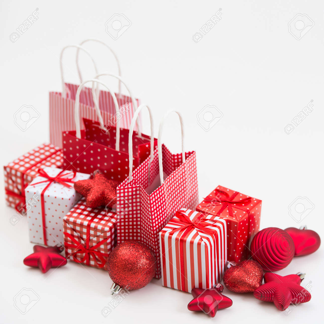 gift boxes with xmas presents wrapped in red paper with ornament on white background lots - Xmas Presents