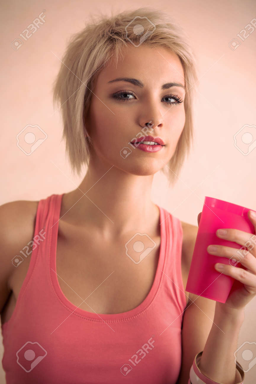 Hot Blond Girl With Short Hair Holding Plastic Cup And Looking Stock Photo Picture And Royalty Free Image Image 29767601