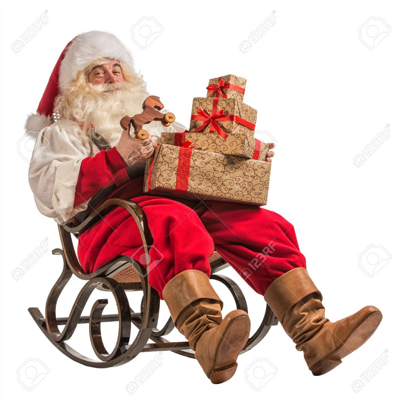 Pere Noel Assis Père Noël Assis Dans Un Fauteuil à Bascule Avec Des Cadeaux Isolé