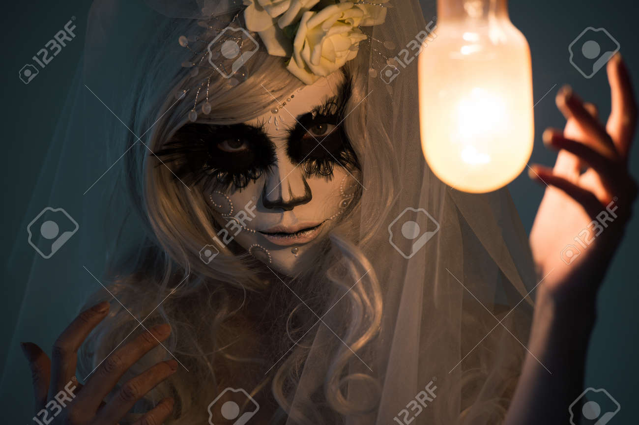 Halloween Witch. Beautiful Woman Wearing Santa Muerte Mask Casting ...