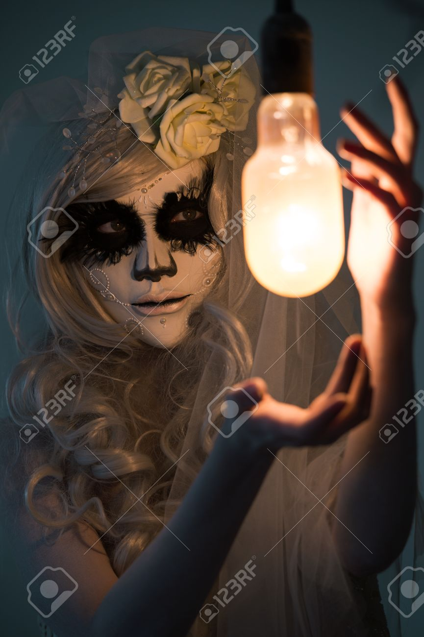 Halloween Witch. Beautiful Woman Wearing Santa Muerte Mask Casting ...