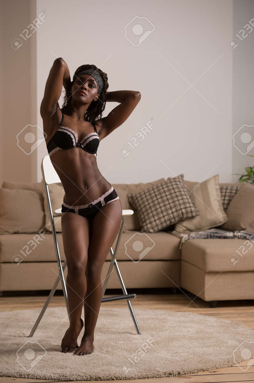 African model wearing black and pink lace lingerie set Stock Photo -  42018078 66d94f4c42