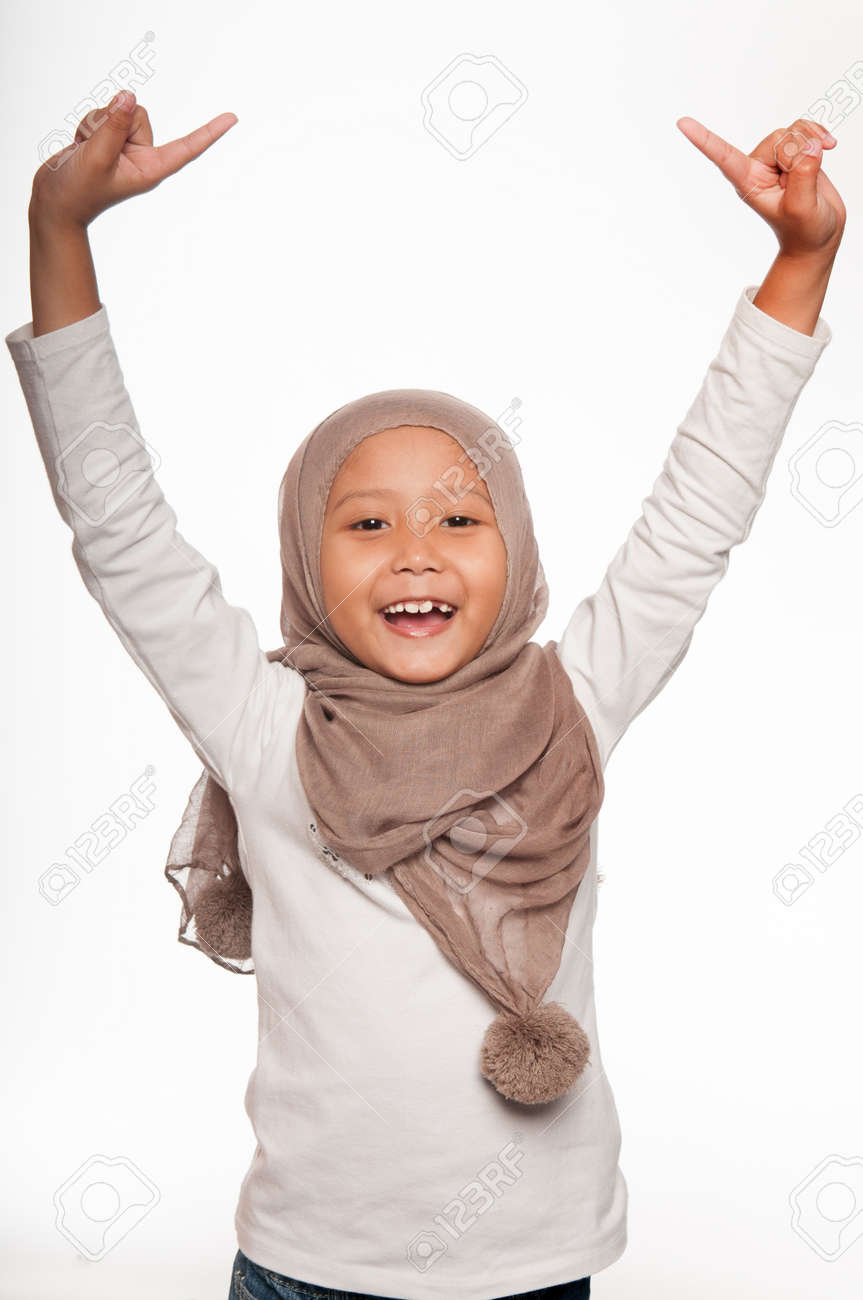 A Malay Little Girl Wearing Head Scarf And Raising Her Both Hands Stock Photo Picture And Royalty Free Image Image 18411601