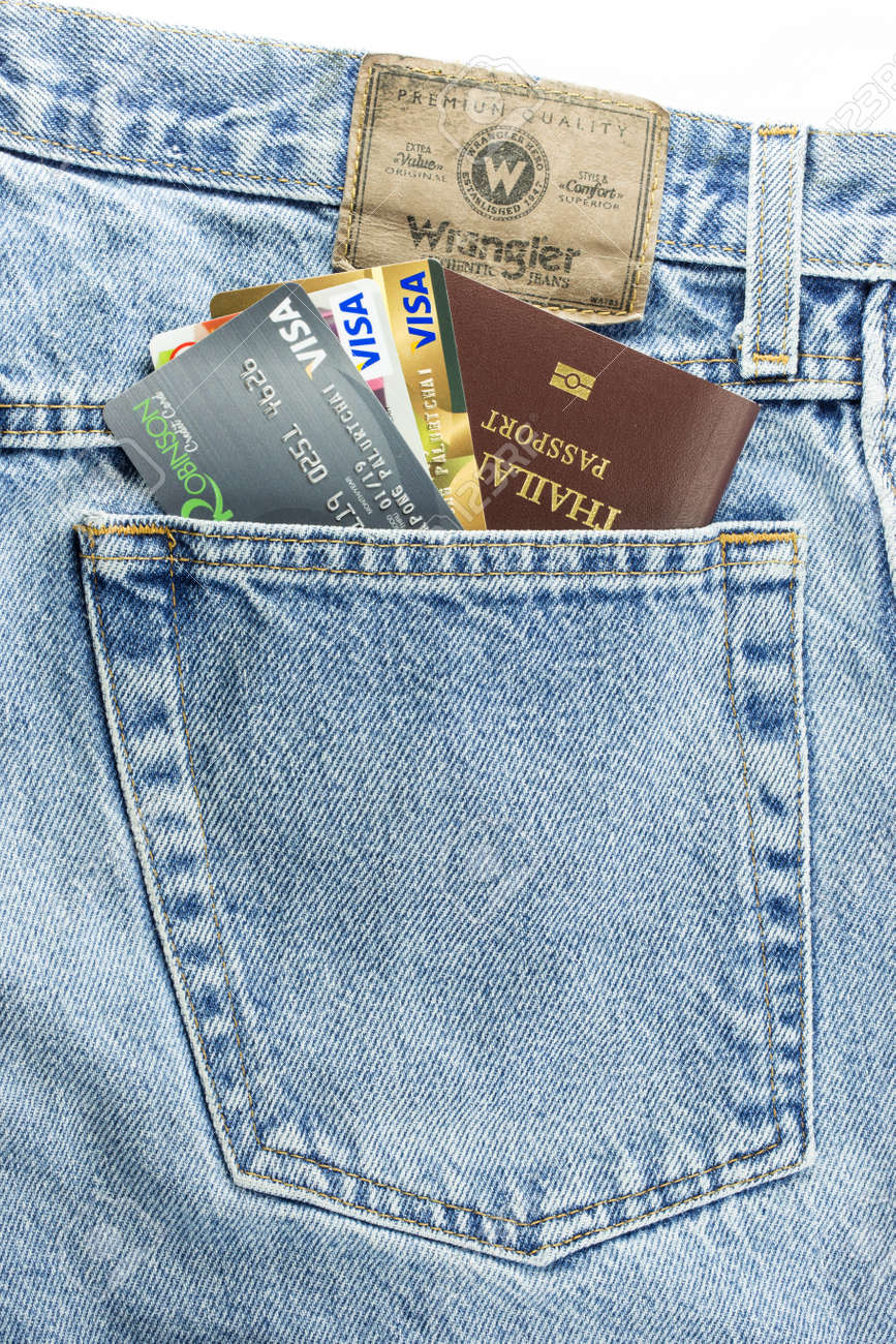 f58b9220 Stock Photo - BANGKOK, THAILAND - March 24, 2014: Closeup of Credit card  and Passport in jeans pocket and wrangler leather label isolated on white  ...