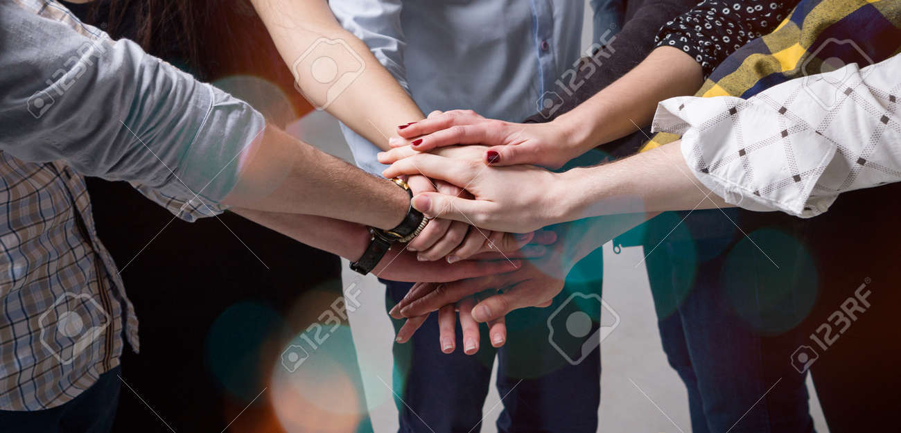 many hands joined together team concept stock photo picture and