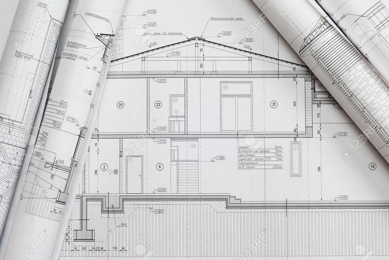 House Plan Blueprints Roled Up Stock Photo  Picture And Royalty    Stock Photo   House plan blueprints roled up