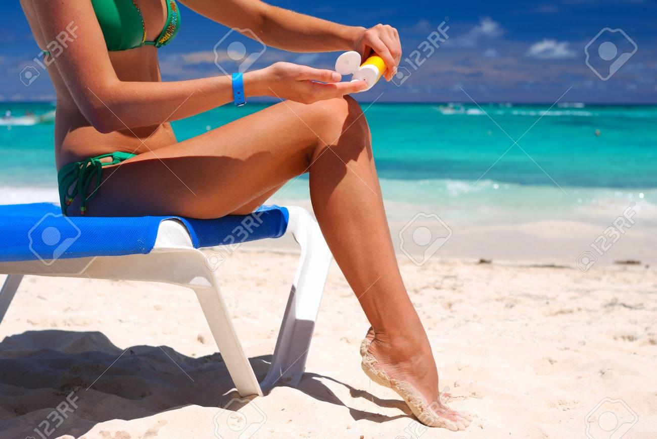 Tan woman applying sun protection lotion Stock Photo - 4582005