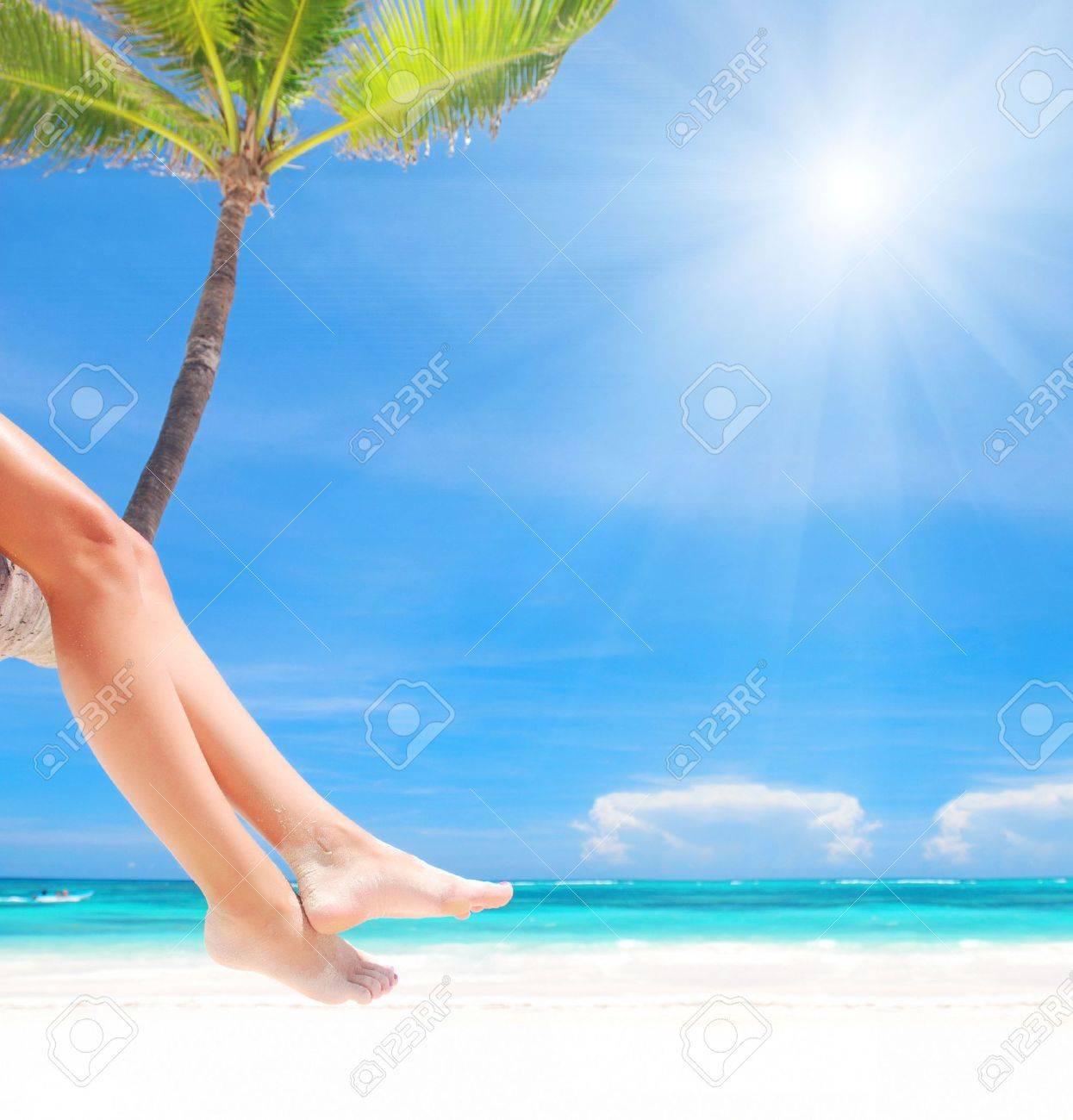 Woman on palm on caribbean beach - 4935628