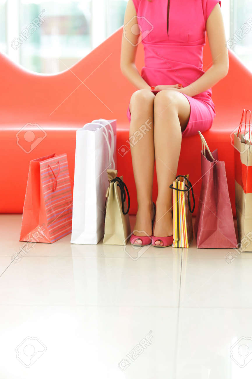 Woman with bags in shopping mall Stock Photo - 5529295