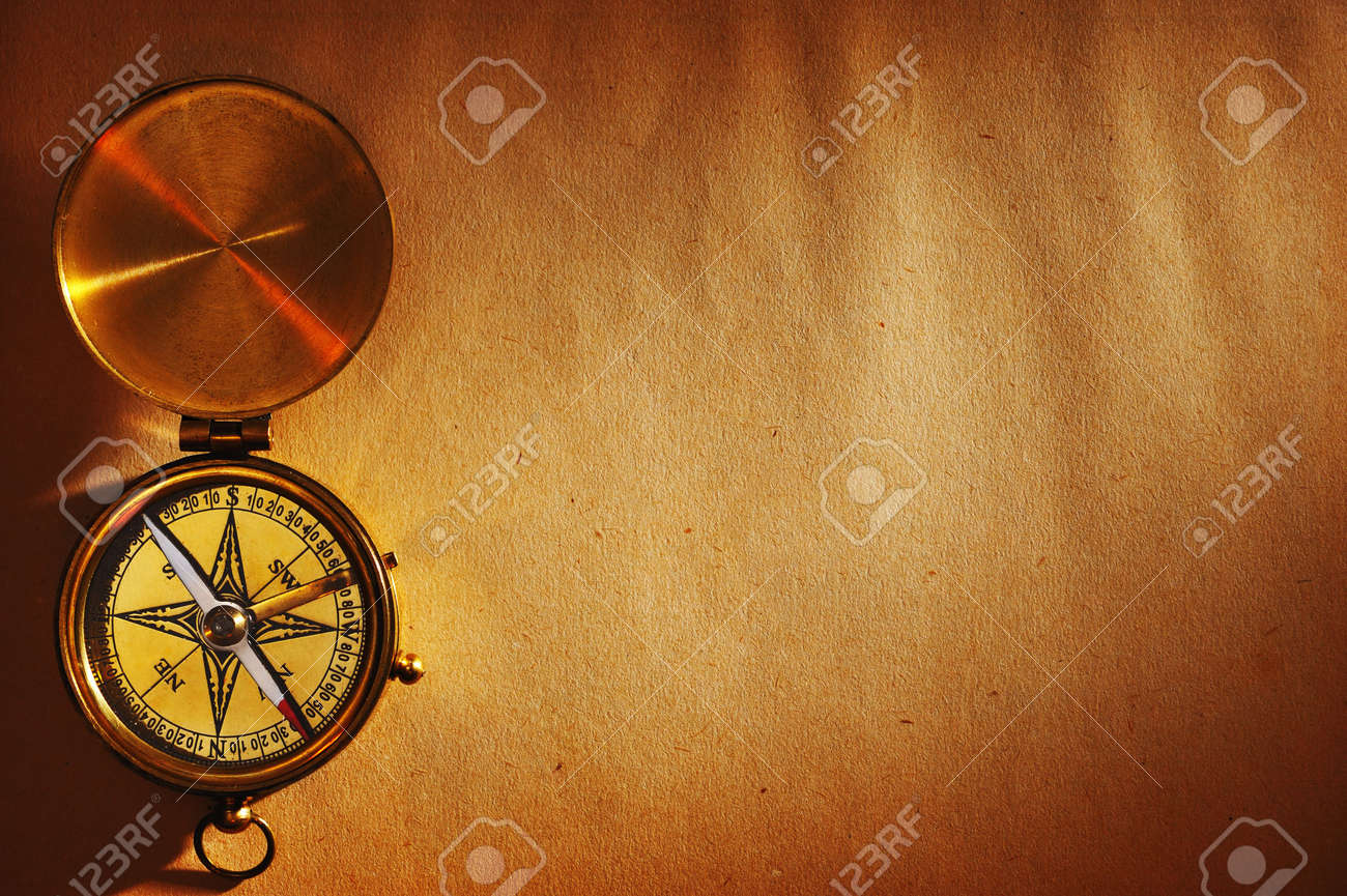 Antique brass compass over old paper background Stock Photo - 5863976