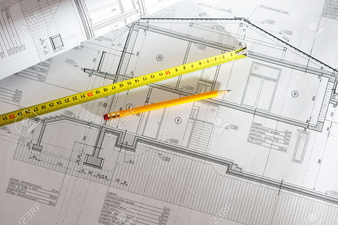 Pencil and tape meausure over house plan blueprints Standard-Bild - 6447376