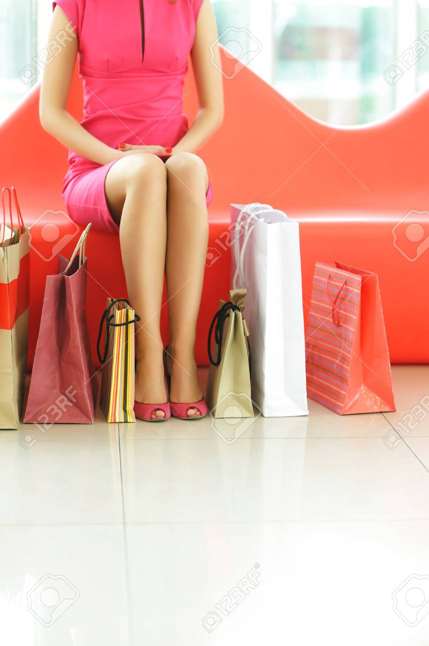 Woman with bags in shopping mall Stock Photo - 6607636
