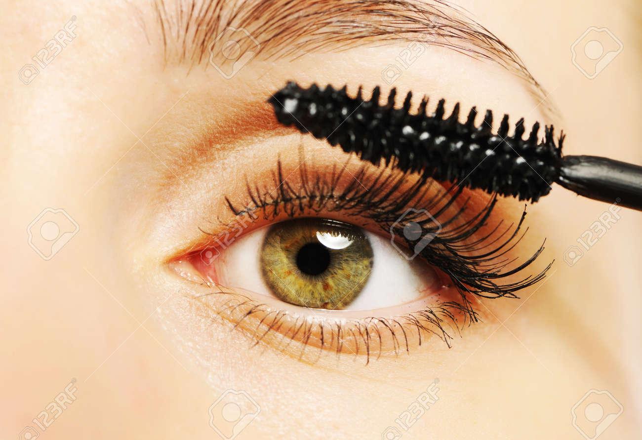 Woman eye with long eyelashes and mascara brush Stock Photo - 7242777