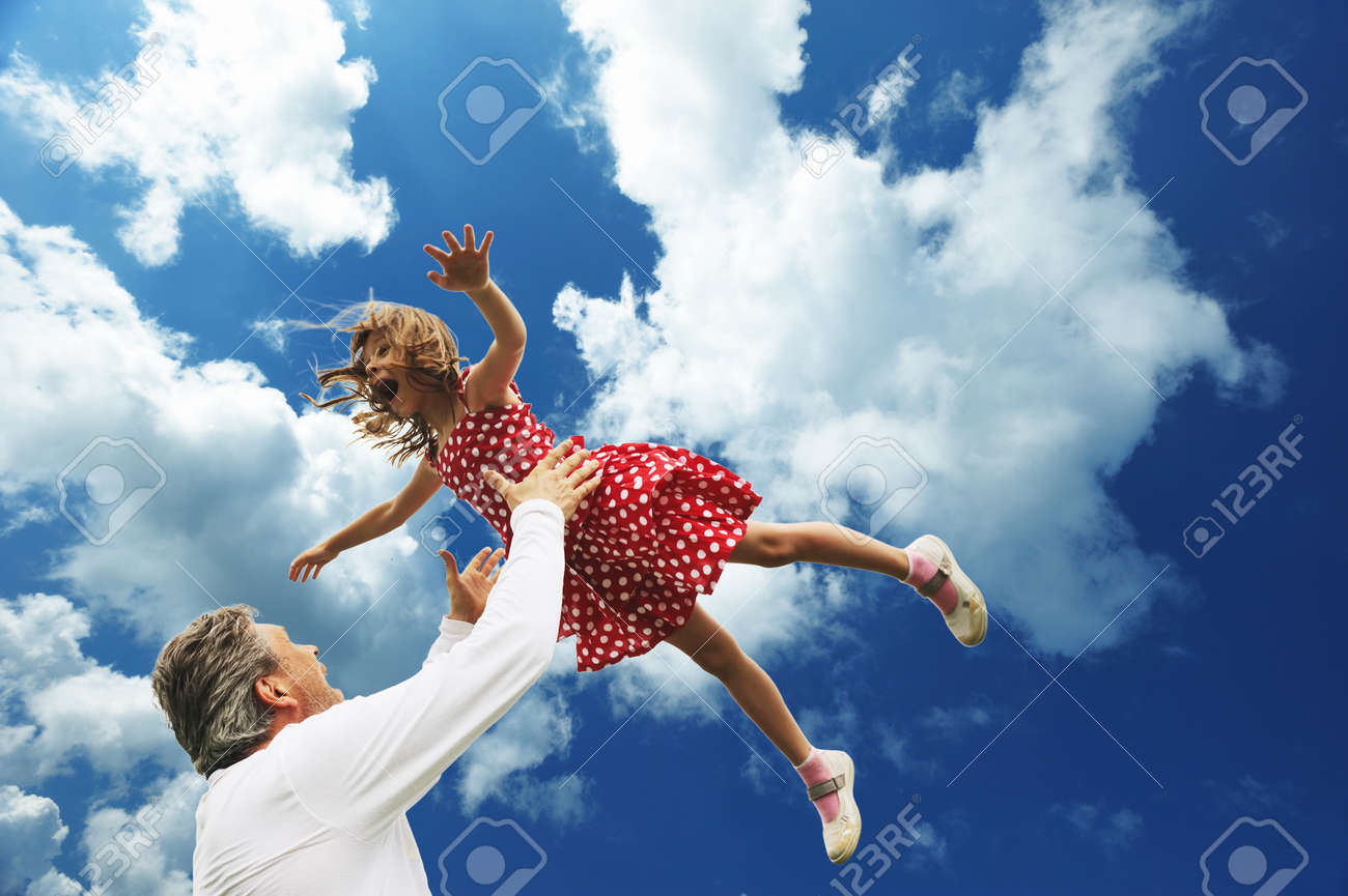 Father and daughter against sky Stock Photo - 7332679