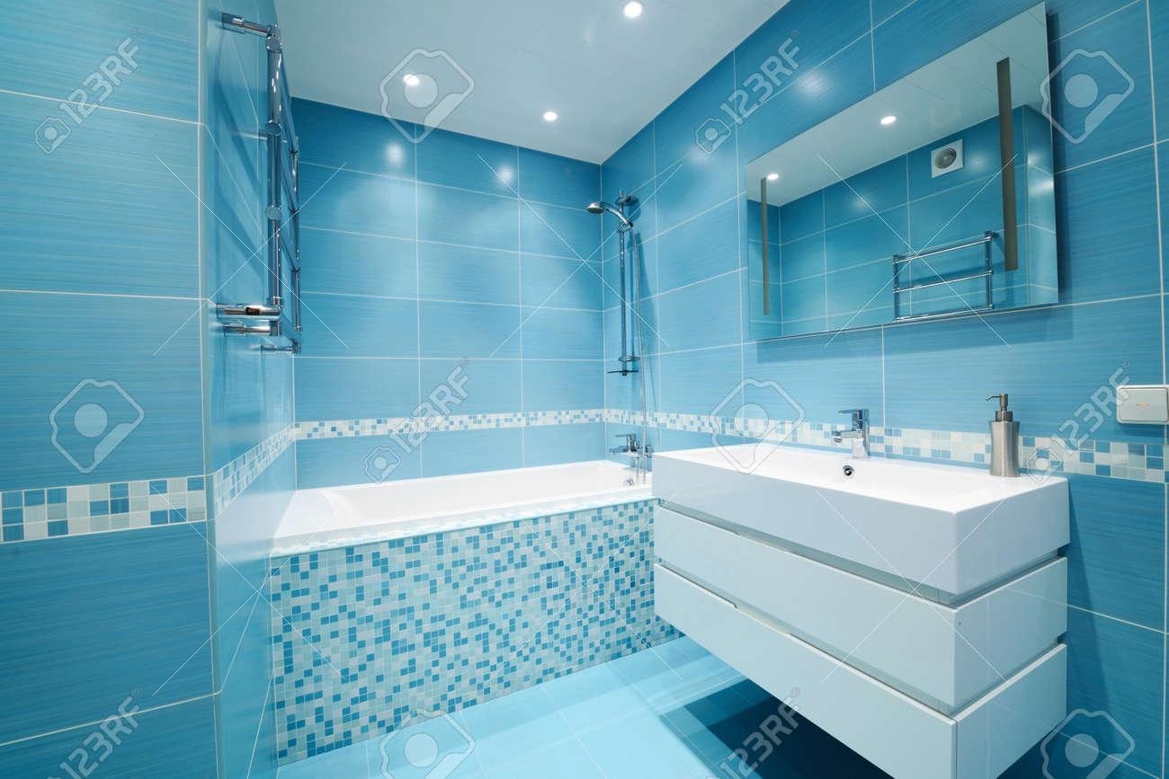 modern luxury bathroom blue interior. no brandnames or copyright