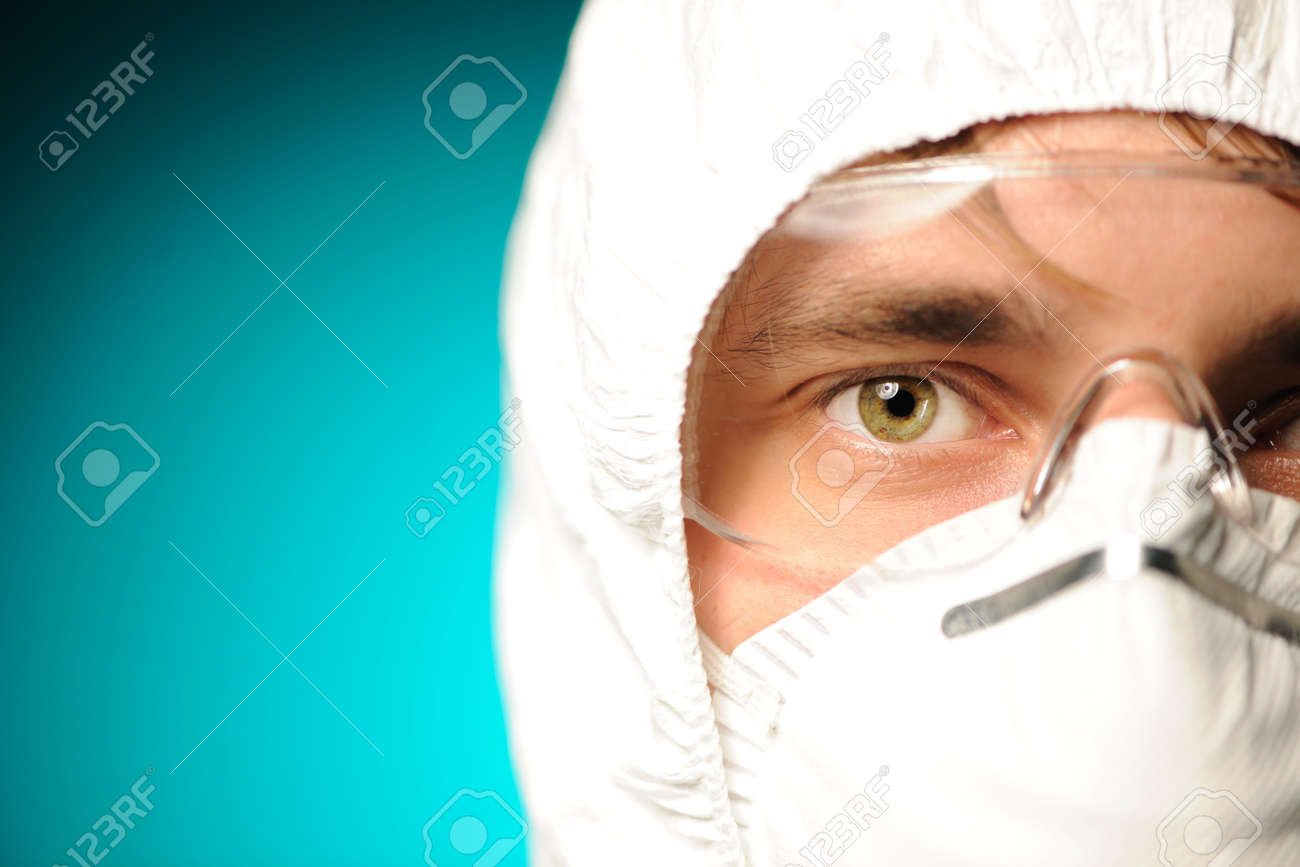 Scientist in protective wear, glasses and respirator Stock Photo - 7837872