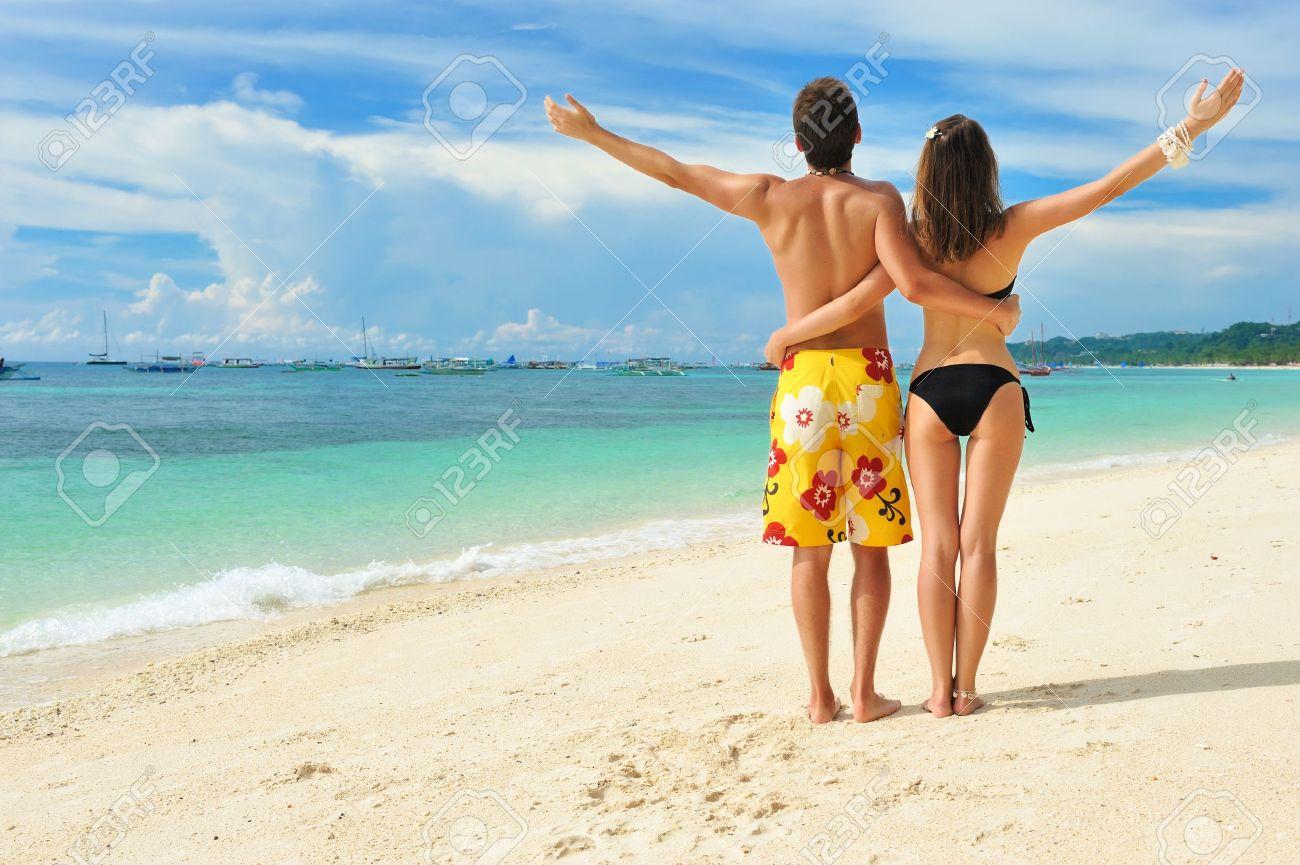 Beautiful couple on a tropical beach Stock Photo - 9213312