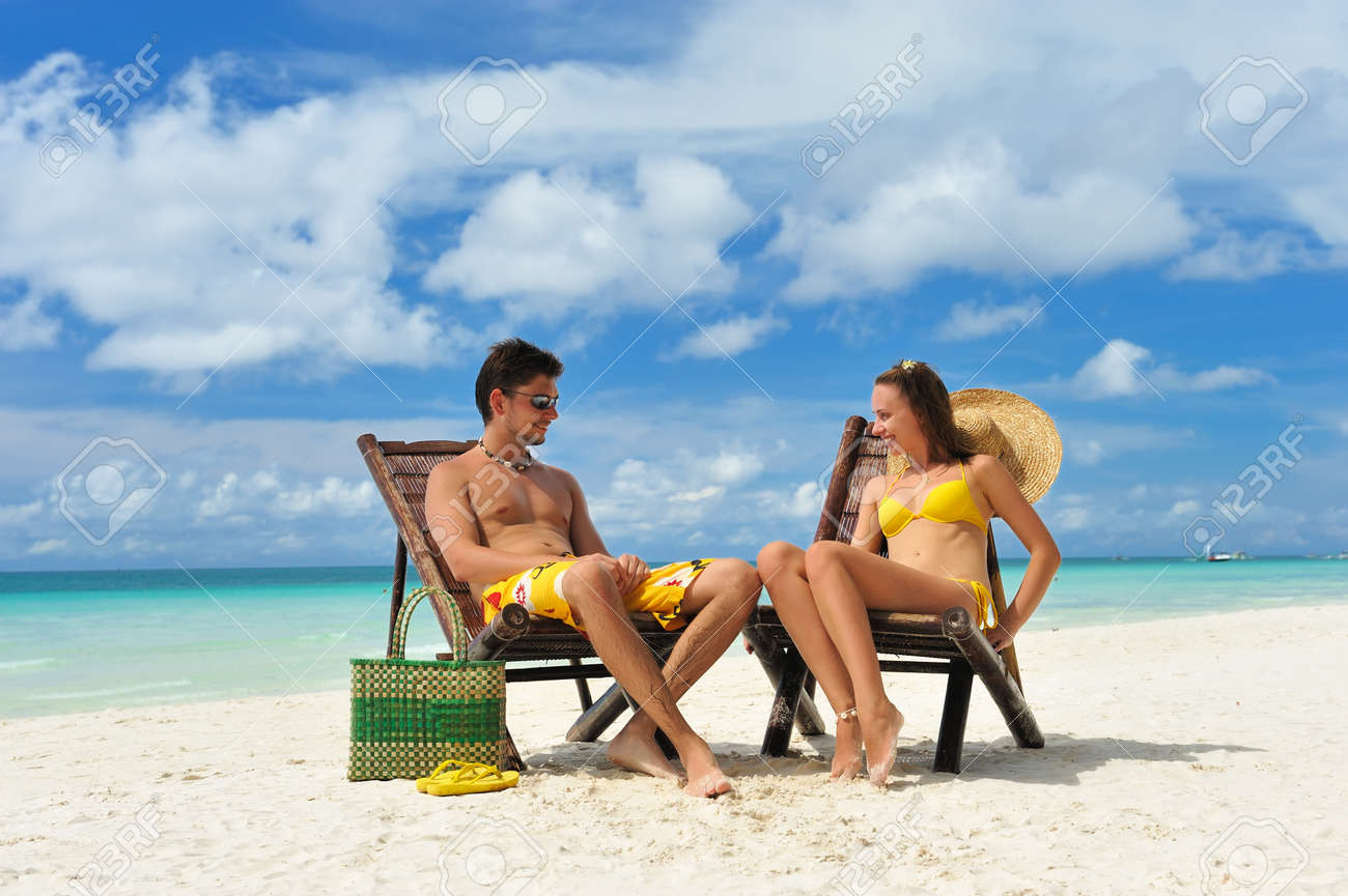 Couple on a tropical beach Stock Photo - 9454438