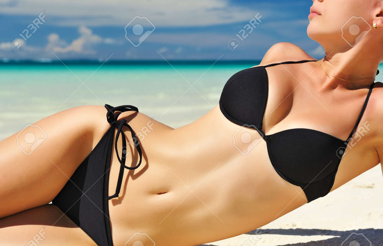 Woman with  beautiful body on a tropical beach Stock Photo - 9585444