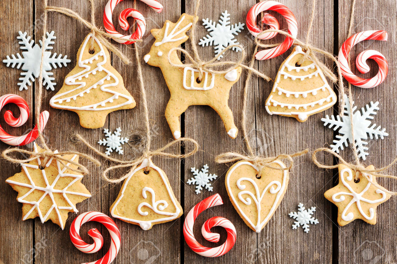 Christmas homemade gingerbread cookies over wooden table Stock Photo - 16235204