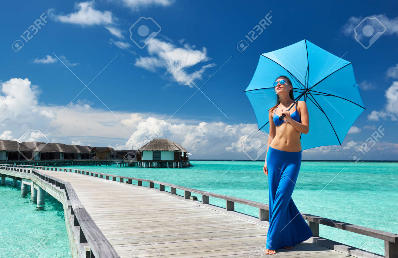 Woman on a tropical beach jetty at Maldives Stock Photo - 19001530