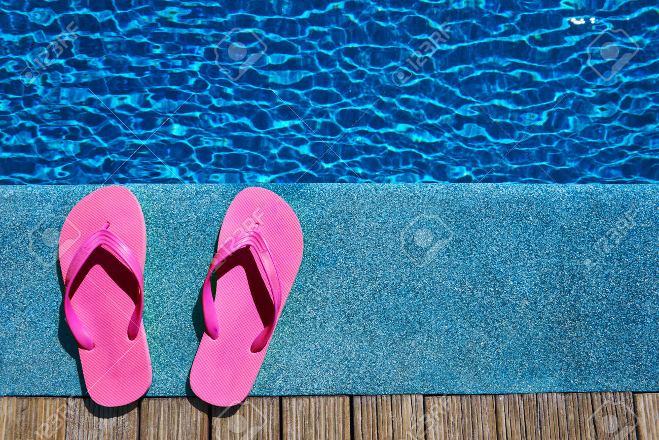 cd99e59398800 Purple slippers by a swimming pool