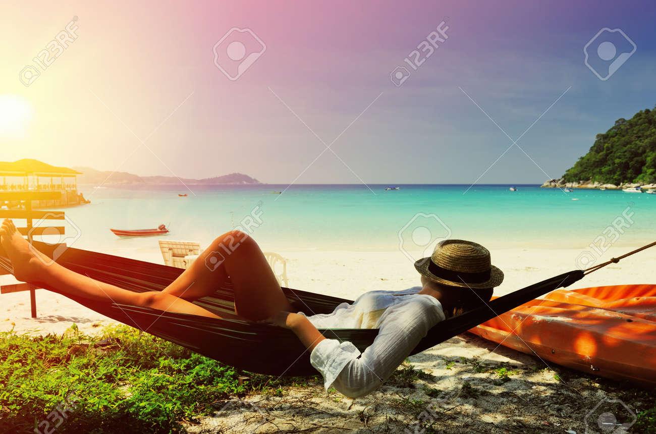 Woman in hammock on tropical beach at Perhentian islands, Malaysia - 53291291