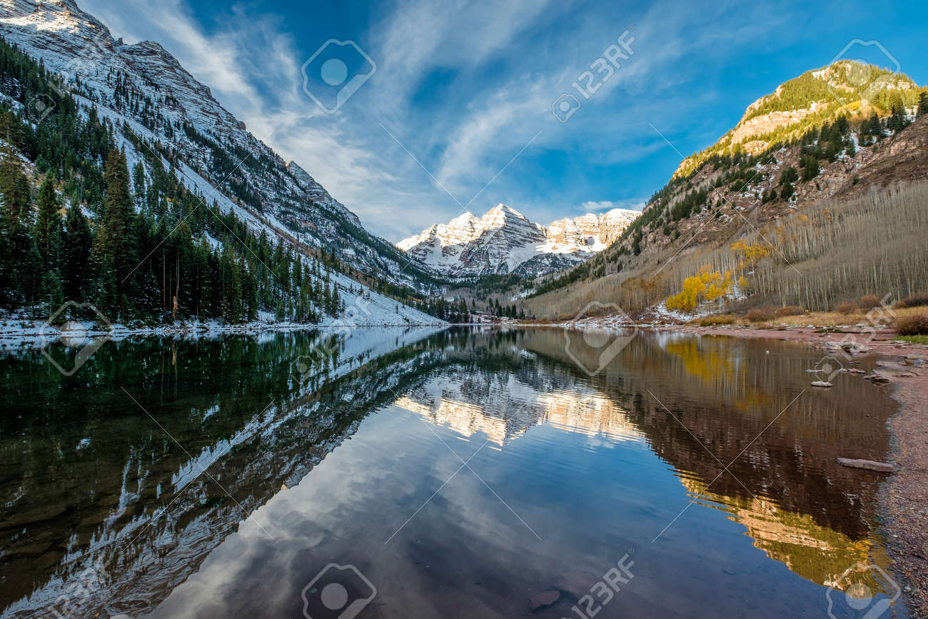 Maroon Bells And Maroon Lake With Reflection Of Rocks And Mountains
