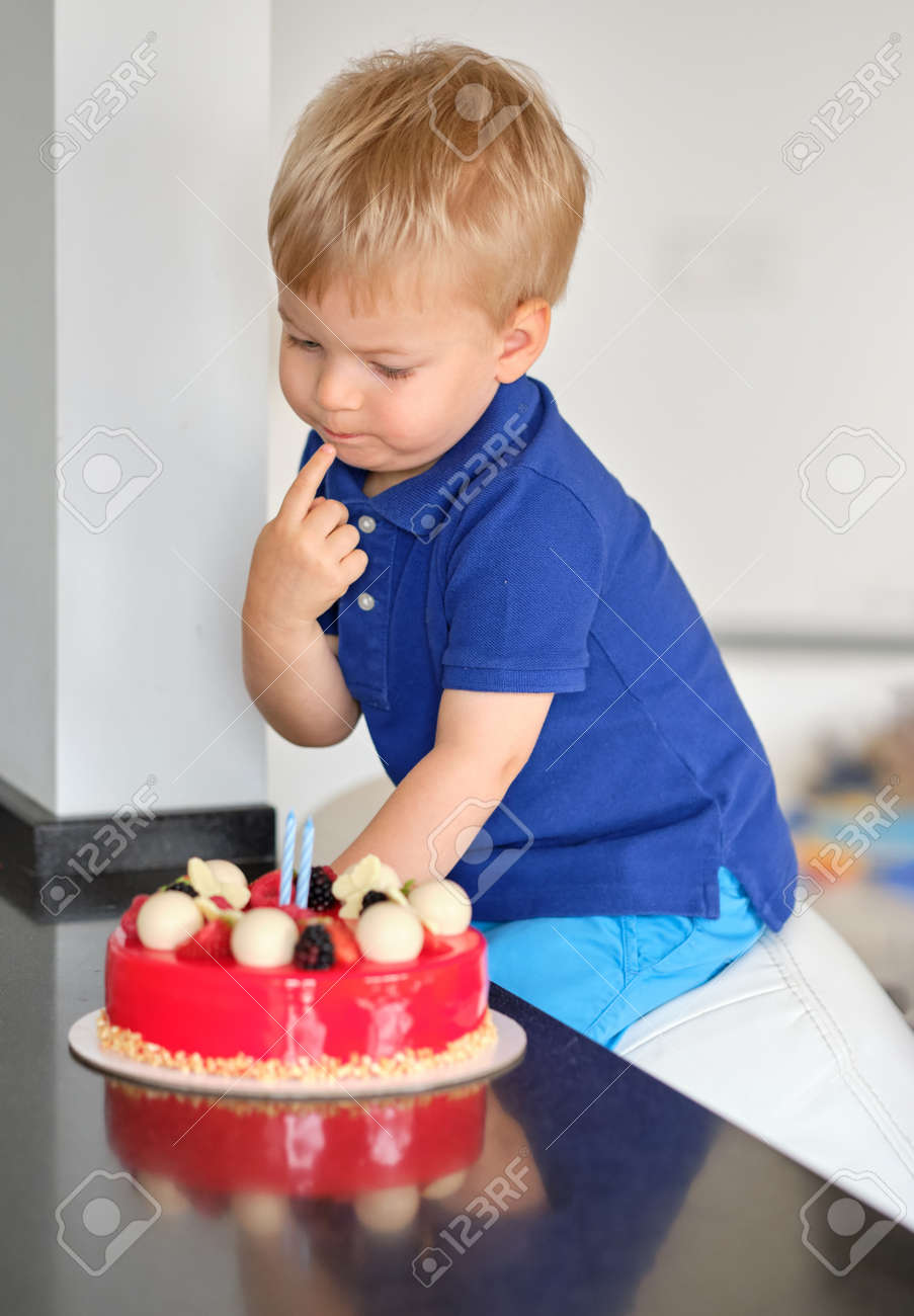 Admirable Two Year Old Boy Trying Birthday Cake Stock Photo Picture And Funny Birthday Cards Online Inifodamsfinfo