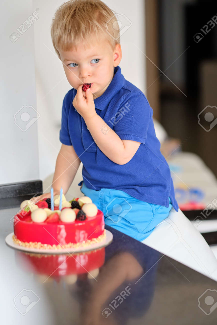 Prime Two Year Old Boy Trying Birthday Cake Stock Photo Picture And Funny Birthday Cards Online Inifodamsfinfo