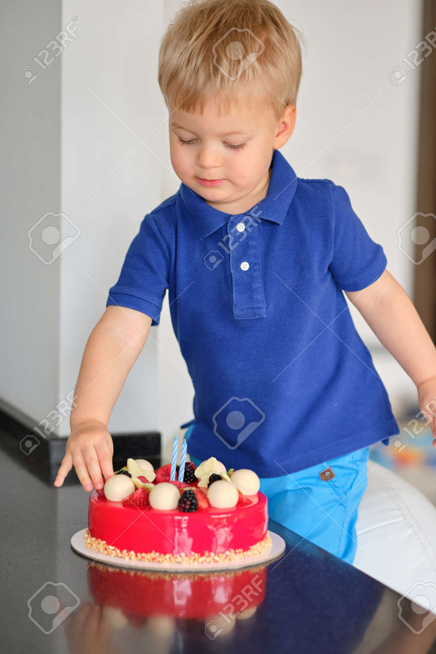 Wondrous Two Year Old Boy Trying Birthday Cake Stock Photo Picture And Funny Birthday Cards Online Inifodamsfinfo