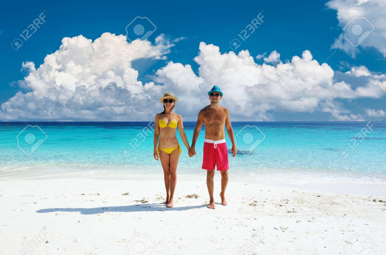Couple walking on a tropical beach. Perhentian islands, Malaysia. - 166315114