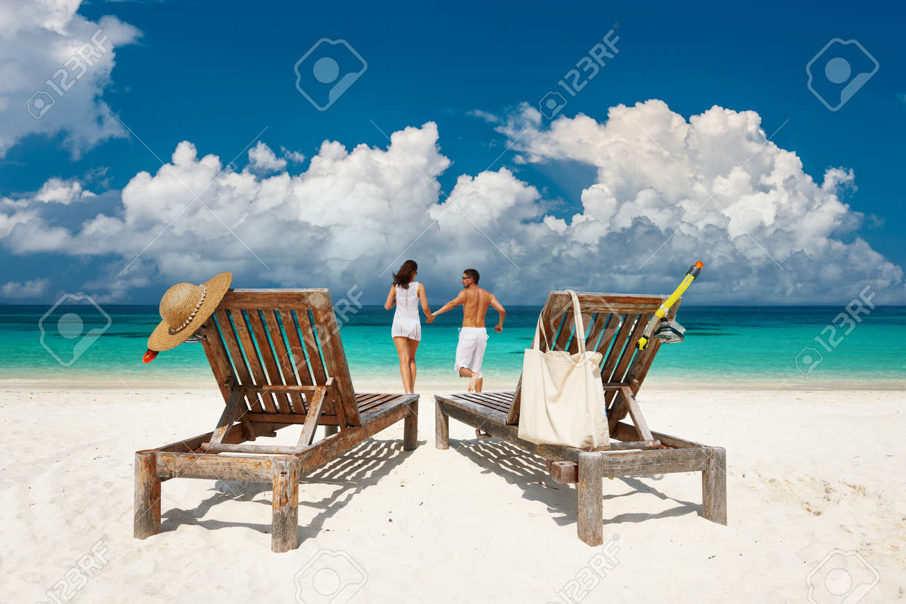 Couple in white running relax on a tropical beach at Maldives - 166657015