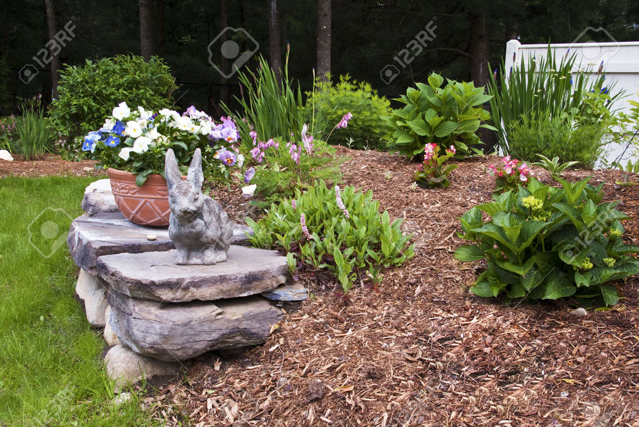 Spring Garden with Rock Wall Stock Photo - 4963587