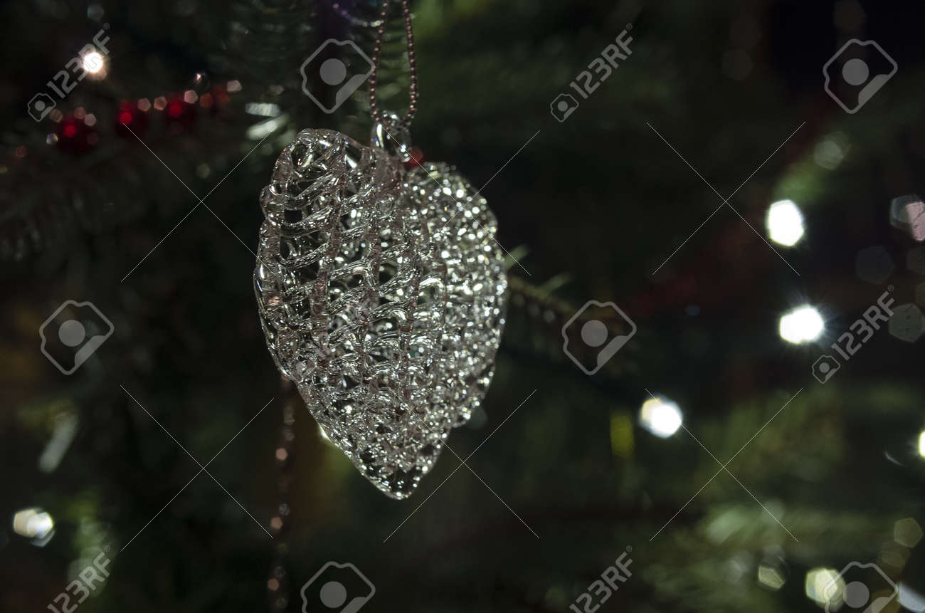 06c01400bc6d5 Closeup of a crystal heart ornament hanging in a Christmas Tree Stock Photo  - 20933341