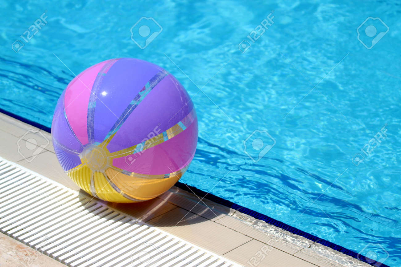 Beachball And Swimming Pool Summer Stock Photo Picture And