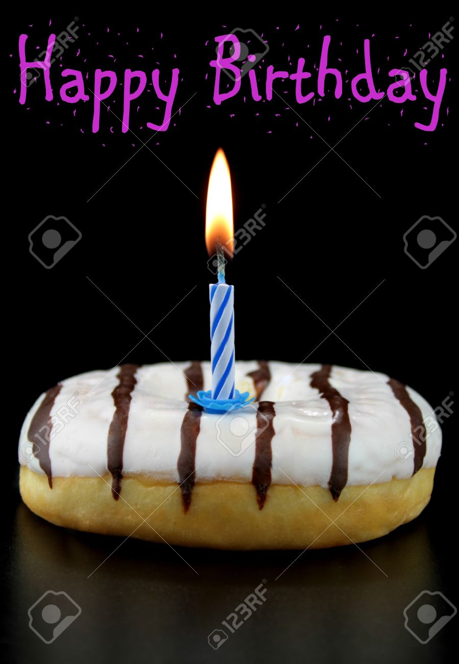 Birthday Candle On A Doughnut With Happy Text Stock Photo