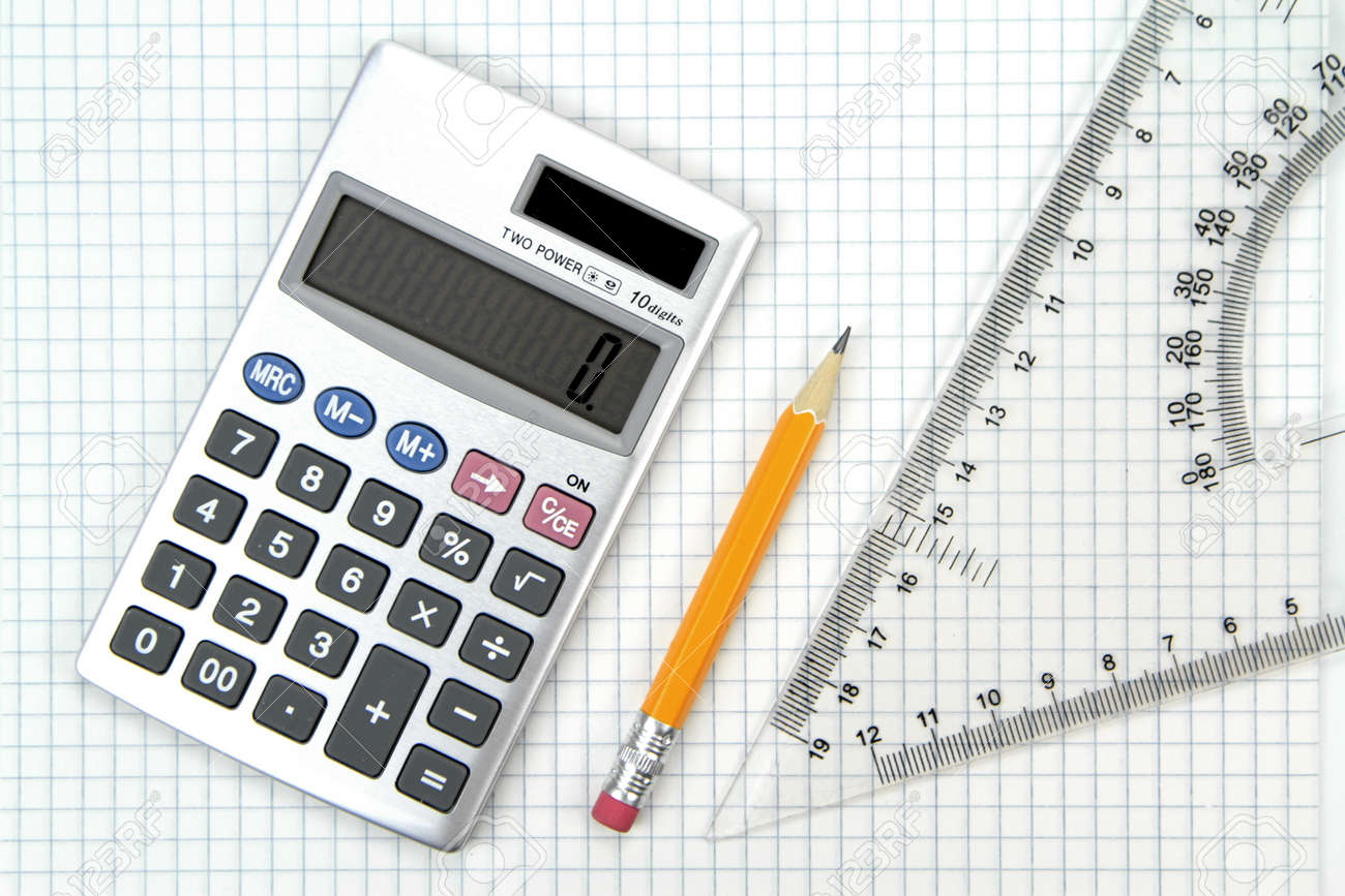 Calculator, Lead Pencil And Ruler On Squared Paper Stock Photo ...