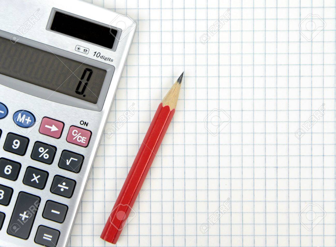 Calculator And Lead Pencil On Squared Paper Stock Photo, Picture ...
