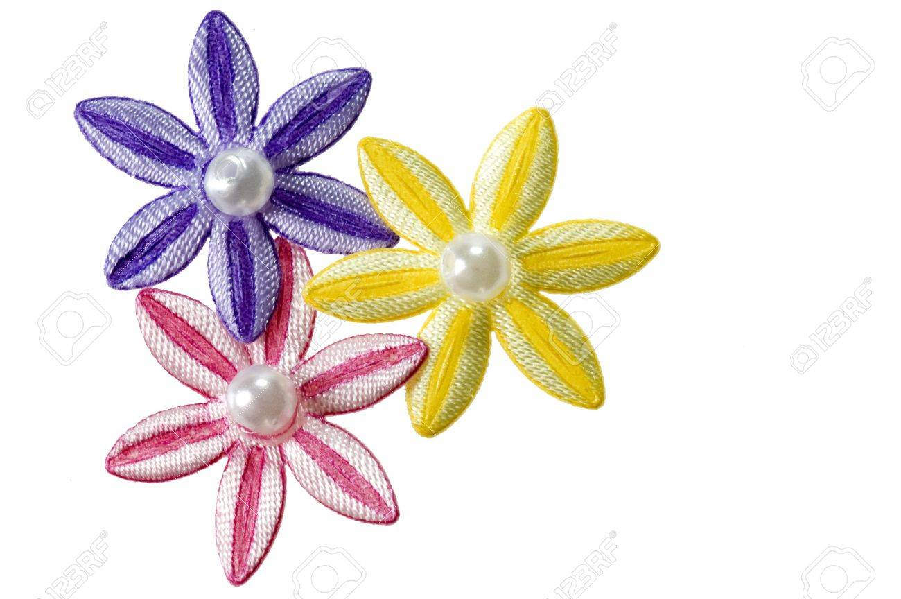 Purple pink and yellow applique flowers isolated on a white