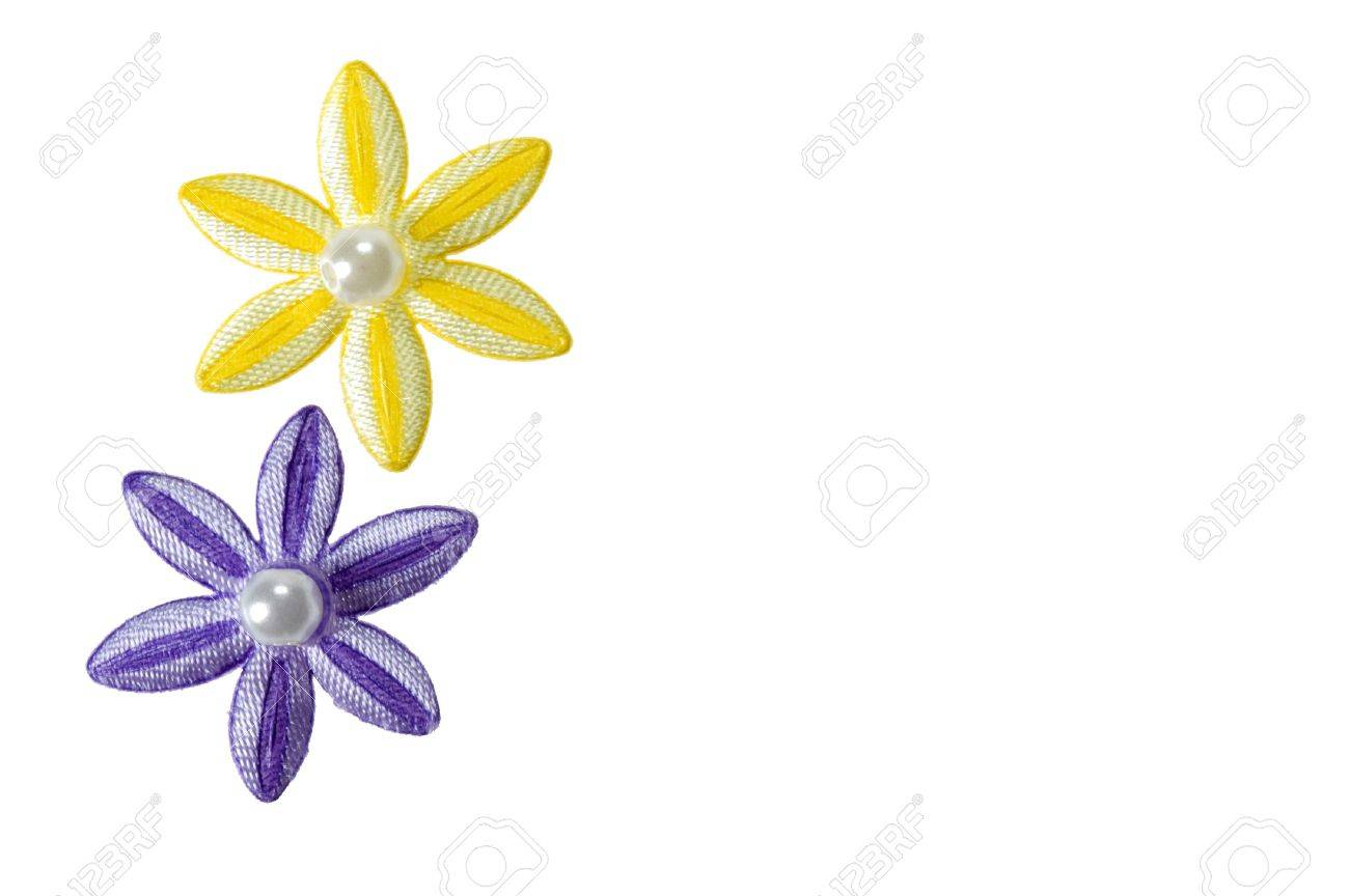 Purple and yellow applique flowers isolated on a white background