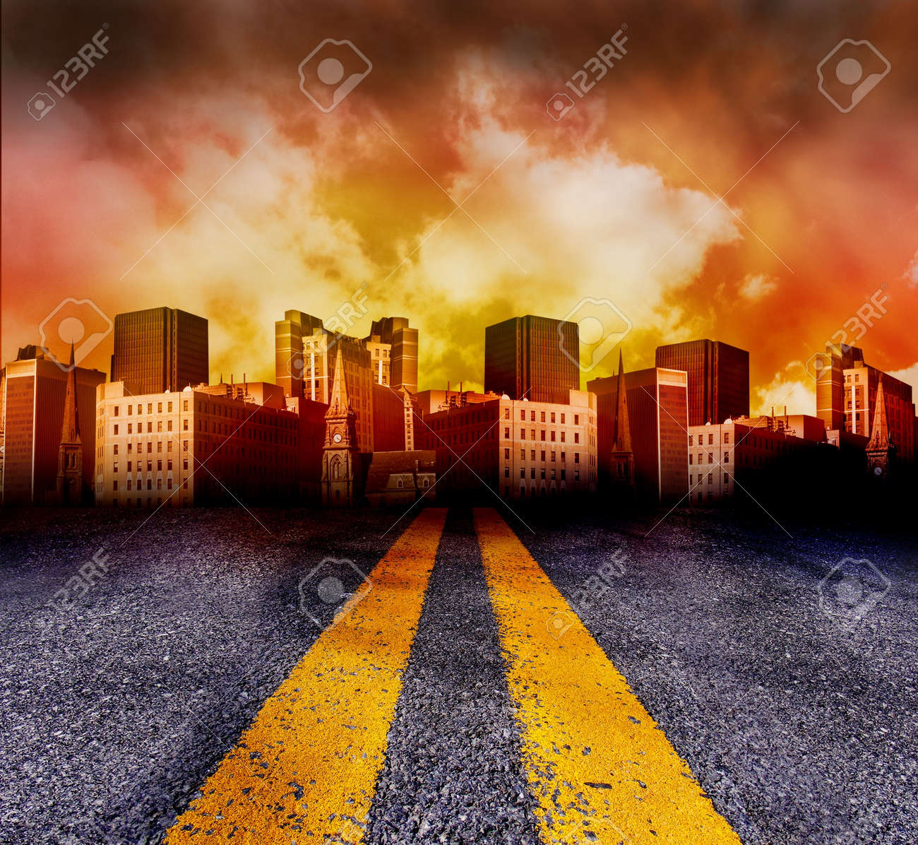 A double yellow line road is leading to a city with a red and yellow sunset in the background. The city is red in color. Stock Photo - 4799686
