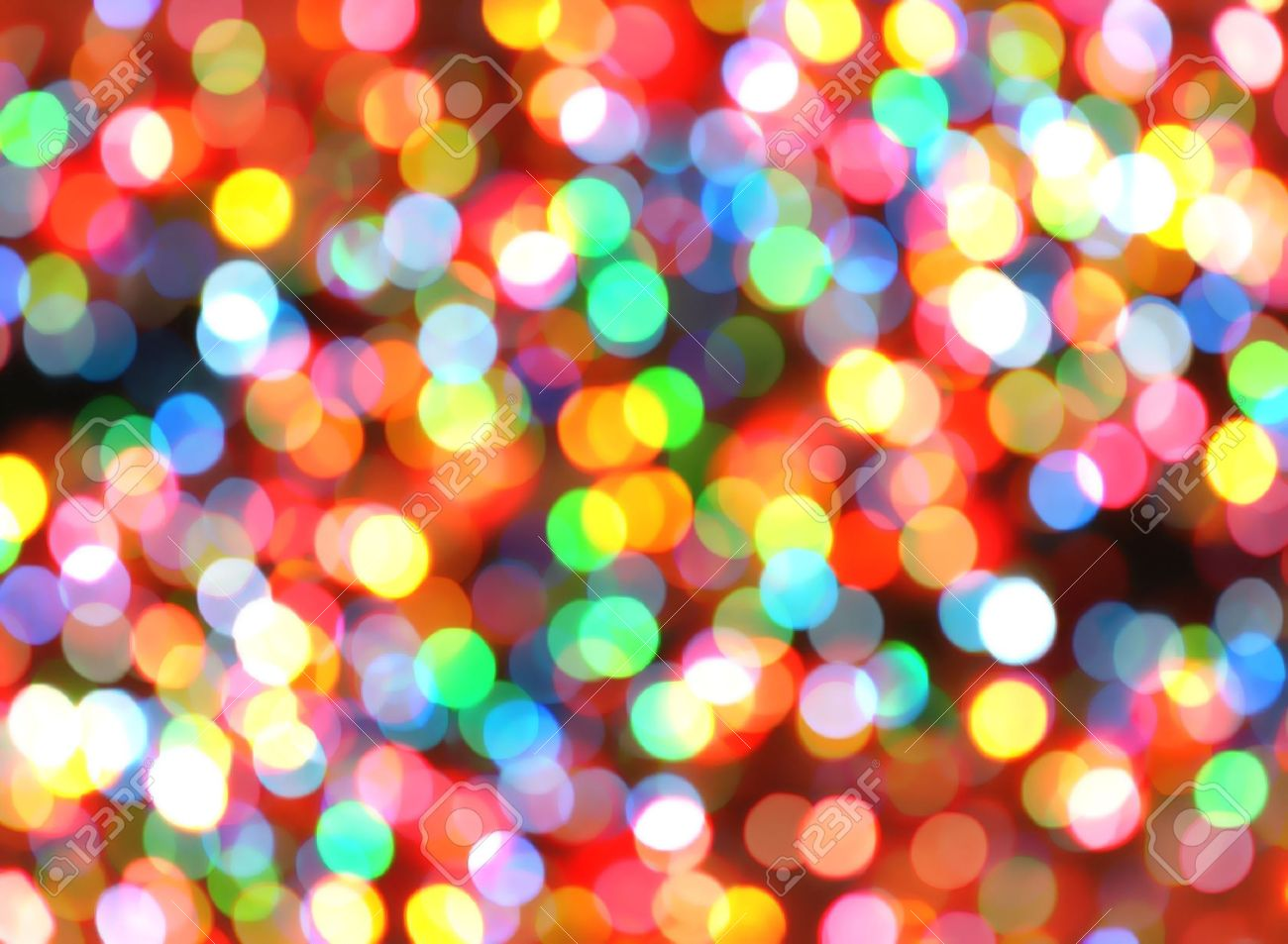 bright, colorful, rainbow lights are blurred and shiny. makes