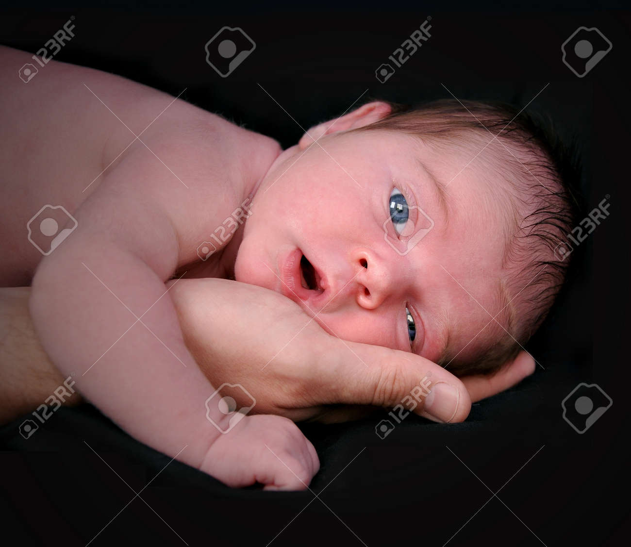 A portrait closeup of a newborn baby child in a father Stock Photo - 17347187