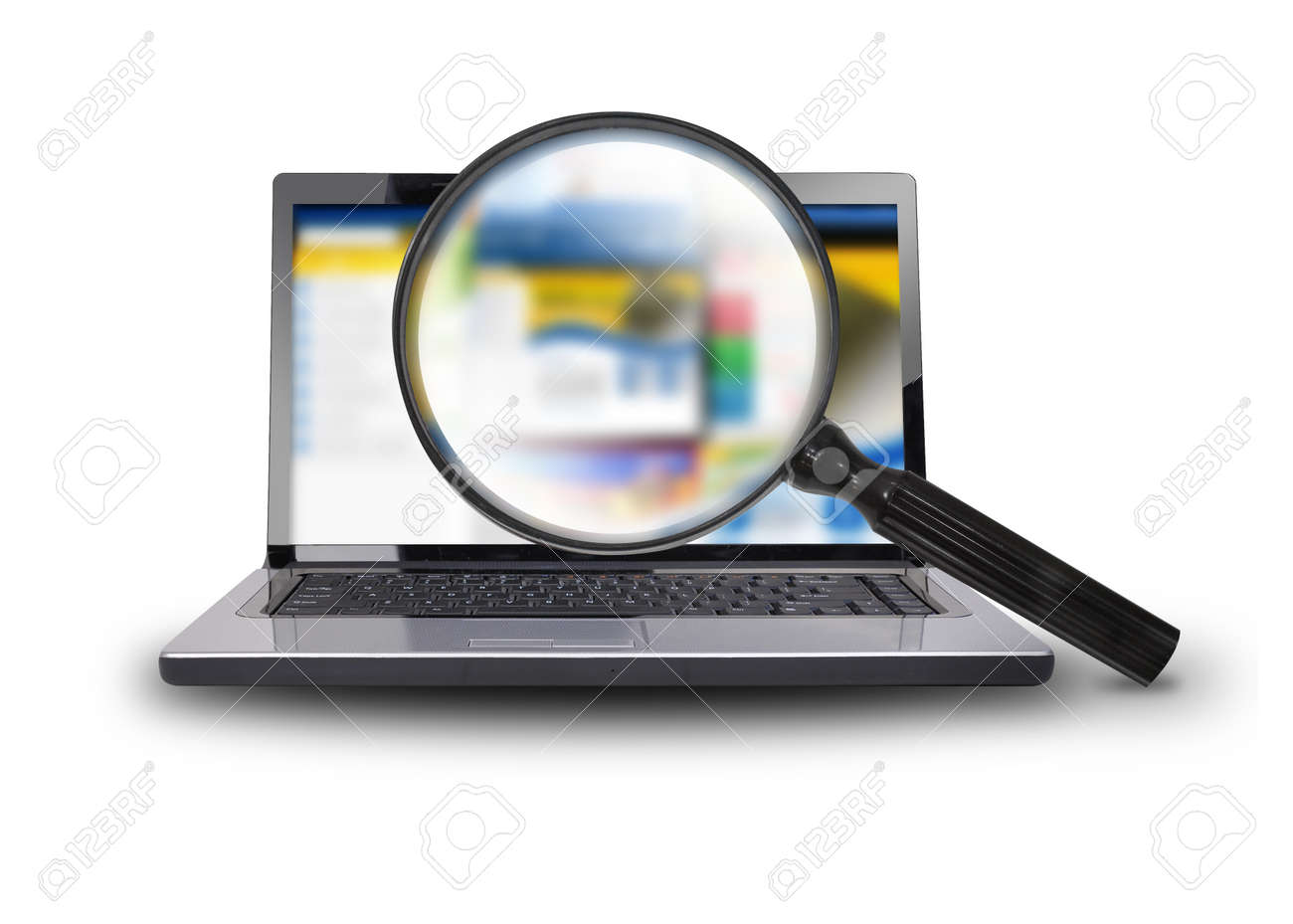 A computer laptop is isolated on a white background with a magnifying glass searching the internet Stock Photo - 17352406