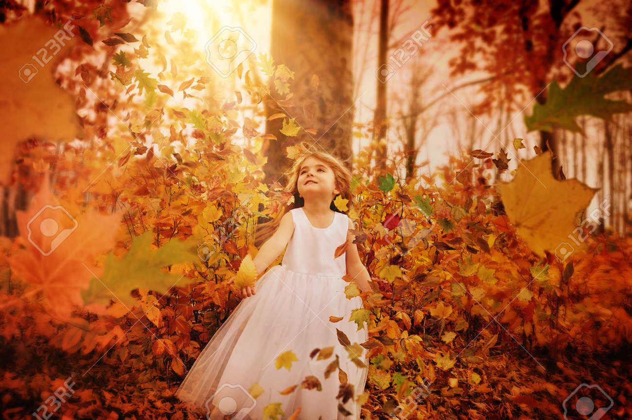 A Little Girl Is In The Woods With Trees And Fall Leaves Blowing Stock Photo Picture And Royalty Free Image Image 33105496