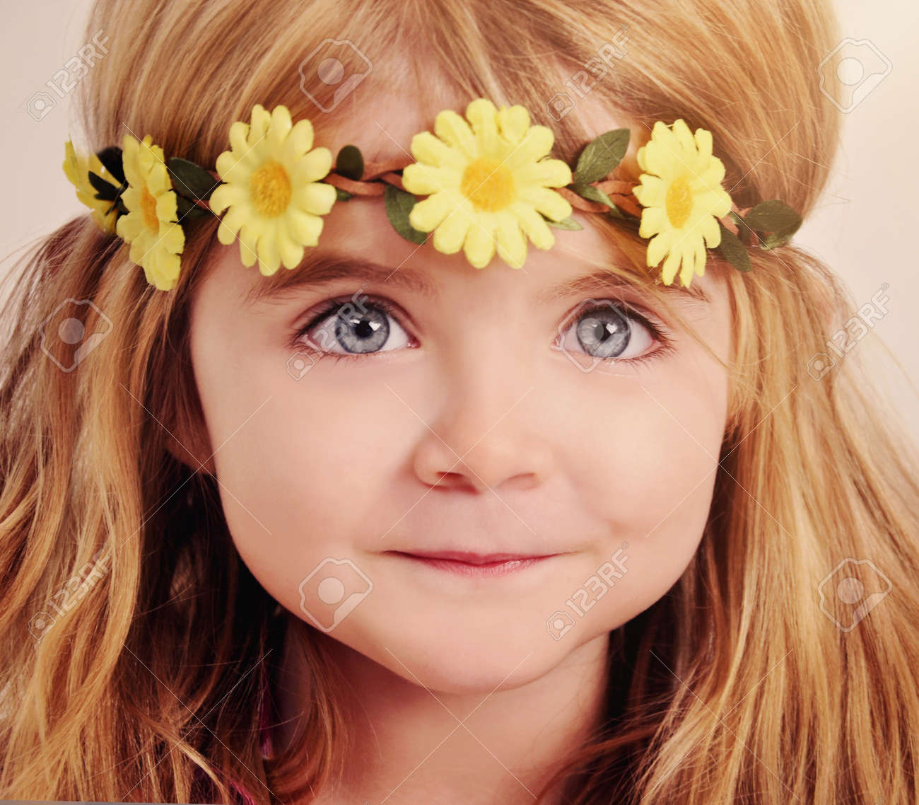 A Closeup Of A Happy Little Girl Wearing A Yellow Flower Garland