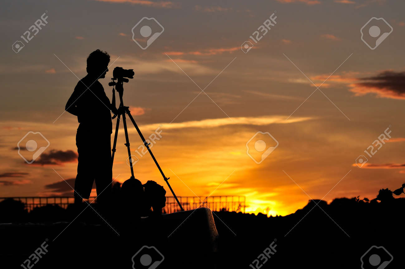 Silhouette of a photographer shooting sunset scene Stock Photo - 3829518